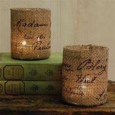 stiklinės aptrauktos maišiniu audeklu, žvakės
