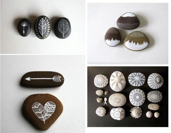 juoda, balta, ruda piešiniai ant akmenėlių